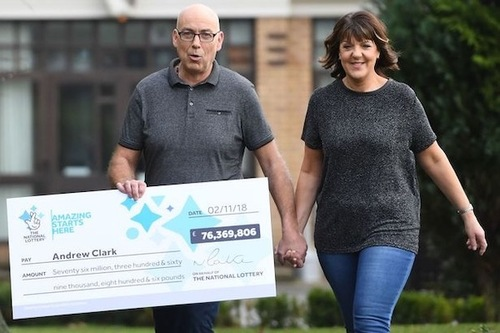 EuroMillions Winner Andrew Clark with Oversized Cheque and Girlfriend Trisha Fairhurst