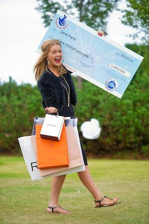 EuroMillions Winner Jane Park with Shopping Bags and Big Cheque