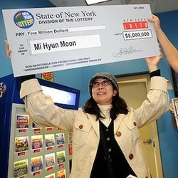 First-Time Lottery Winner Mi Hyun Moon Holding Oversized Check