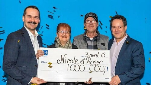 Loto Quebec Winners Nicole Pedneault and Roger Larocque with Oversized Cheque