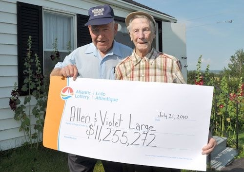 Lotto 649 Winners Violet and Allen Large With Oversized Cheque