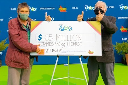 Lotto Max Winner James Wickman with Wife and Oversized Cheque