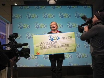 Lotto Max Winner Kathryn Jones Holding Oversized Cheque