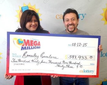 Mega Millions Winners Emaley and Alex Escalera Holding Oversized Check