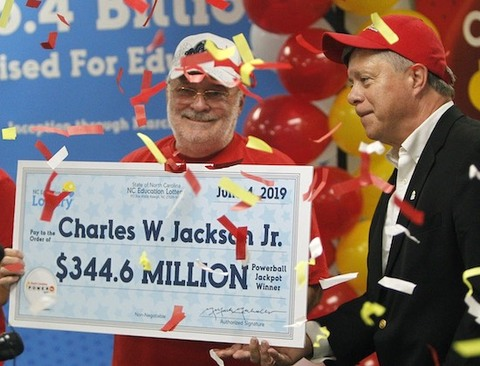 Powerball Winner Charles W. Jackson Jr. Holding Oversized Cheque Square
