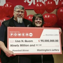 Powerball Winner Lisa Quam Holding Large Check with Husband