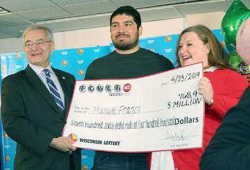 Powerball Winner Manuel Franco with Oversized Cheque