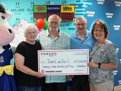 Powerball Winner Thomas Cook with Friend Joe Feeney and Wives Holding Oversized Cheque